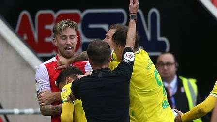 Angus MacDonald is red carded for his lunge on Norwich City midfielder Olly Skipp Picture: Paul Ches