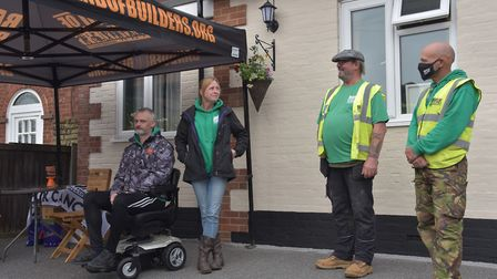The volunteers working for Band Of Builders in Norwich this week complete the project on Chris Joy's