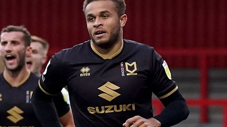 Carlton Morris scored as MK Dons recorded their first league win of the season against Gillingham. P