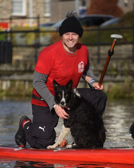Millie enjoying paddle boarding with her owner, Paul 'Chuck' Norris, of Bush Adventures Uk, on the r