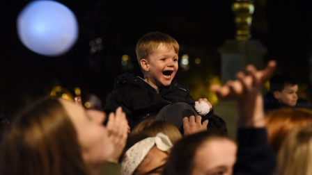 One child enjoying the snowballs as Norwich Christmas lights are switched on. Picture: DENISE BRADLE