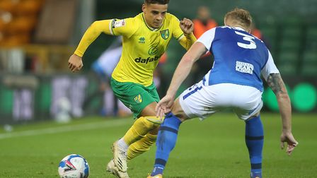 Max Aarons of Norwich takes the ball round Kristian Pedersen of Birmingham City during the Sky Bet C