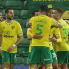 The Norwich players celebrate after Mario Vrancic, second from left, scored the crucial late goal ag