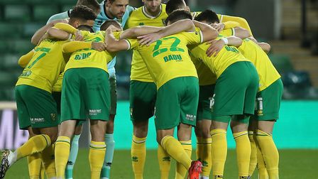 The Norwich players in the pre match huddle before the Sky Bet Championship match at Carrow Road, No