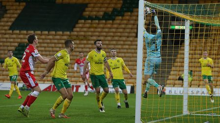 Tim Krul of Norwich collects the ball safely from under his own crossbar late on during the Sky Bet
