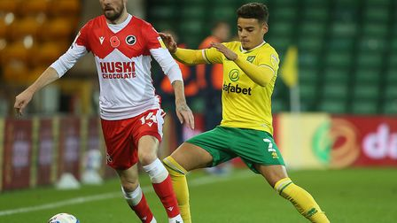 Max Aarons keeps a tight leash on Millwall left-back Scott Malone during Norwich City's 0-0 home dra
