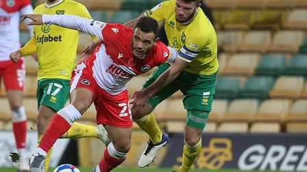Norwich City captain Grant Hanley battles with Millwall substitute Mason Bennett during the 0-0 draw
