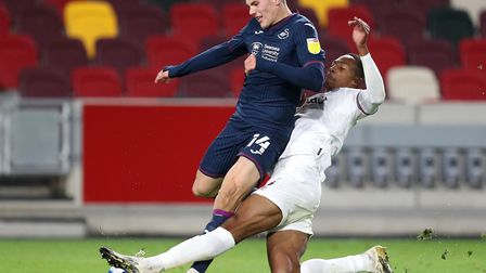 Swansea City's Viktor Gyokeres is tackled by Brentford's Ethan Pinnock during the midweek draw in we
