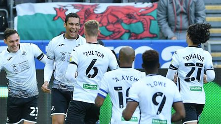 Swansea are Championship contenders again under Steve Cooper, according to Swans fan Guto Llewelyn.
