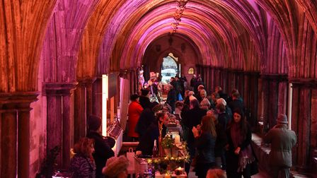 The market stalls in the colourful cloisters for the Norfolk Christmas Fayre at Norwich Cathedral. P