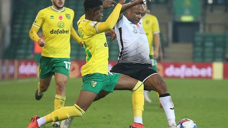 Bali Mumba tussles with Swansea and Ghana striker Andre Ayew during Norwich City's home victory Pict