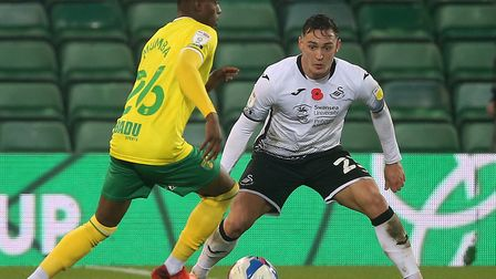 Norwich City youngster Bali Mumba up against Swansea City's Connor Roberts Picture: Paul Chesterton