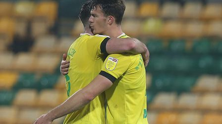 Grant Hanley of Norwich and Christoph Zimmermann of Norwich at the end of the Sky Bet Championship m