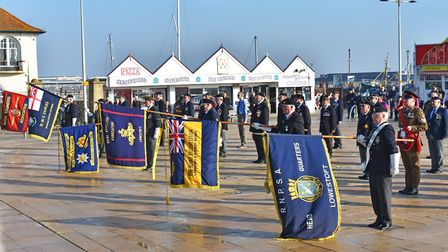 Standards bearers, cadets and veterans at the unofficial remembrance event at Lowestoft war memorial