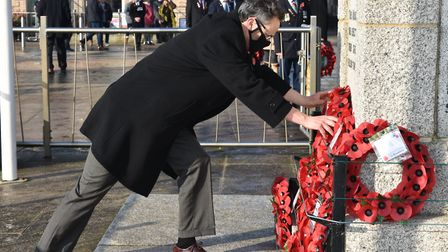 Waveney MP Peter Aldous lays a wreath at the unofficial remembrance event at Lowestoft war memorial