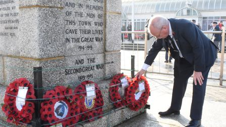 East Suffolk councillor Keith Robinson lays a wreath at the unofficial remembrance event at Lowestof
