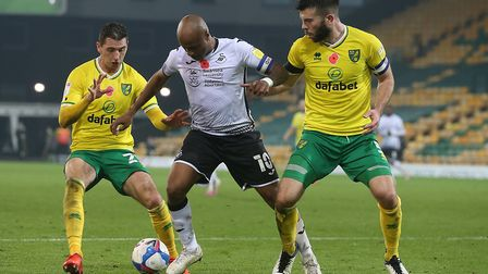 Kenny McLean and Grant Hanley, right, keep a close eye on Swansea striker Andre Ayew Picture: Paul C
