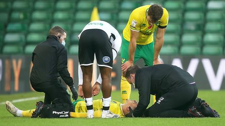 Max Aarons was told to stay down for treatment by medical staff after a blow to the head during City