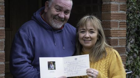 Martin and Nikki Rodwell, with the letter they received from the Lord Lieutenant of Norfolk. Picture