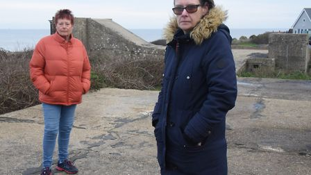 Mundesley Action 4 Cardiac Hill campaigners Bev Reynolds, left, and Denise Revell, with the concrete
