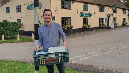Ali Murphy, restaurant manger at the Banningham Crown pub near Aylsham, delivers free beer to some r