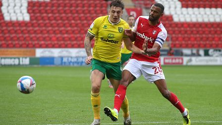 Jordan Hugill of Norwich and Michael Ihiekwe of Rotherham United in action during the Sky Bet Champi
