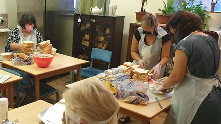 Volunteers at the Silver Road Community Centre make sandwiches for their food parcels. Pic: Julie Br