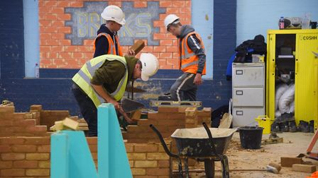 Some of the construction students at work at the St Edmunds Society. Picture: DENISE BRADLEY