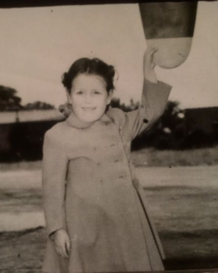 Viriginia Ottaway as a child, touching the propeller of an aircraft. Her father, Sergeant Jack Ottaw