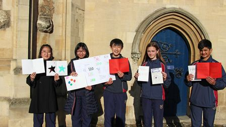 Norwich School pupils with cards, messages and poems from pupils to mark the 100th birthday of Tony
