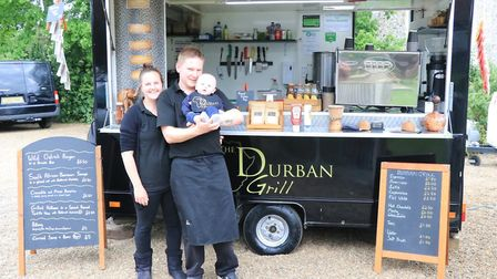 Clare Whitmore and Adam Davies with their son Connor at their street food van The Durban Grill Pictu