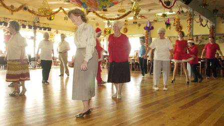 Line-dancing during early Christmas week in the ballroom at Mundesley Holiday Camp in 2001. Picture: