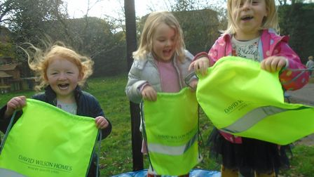 Fairview Kindergarten children jumping for joy with their new kit bags for Road Safety Week. Picture