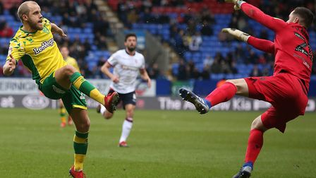 Teemu Pukki lobs his second goal over Remi Matthews in Norwich City's romp at Bolton Wanderers Pict