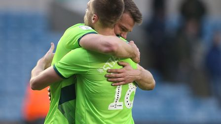 An emotional Christoph Zimmermann embraces Marco Stiepermann, as Norwich City return to the top of t