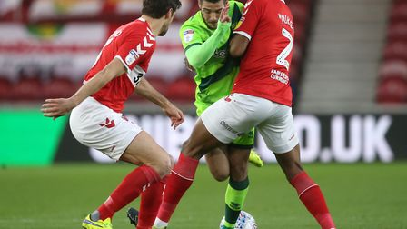 Emi Buendia, the meat in a Boro sandwich as he tries to get past George Friend and John Obi Mikel Pi