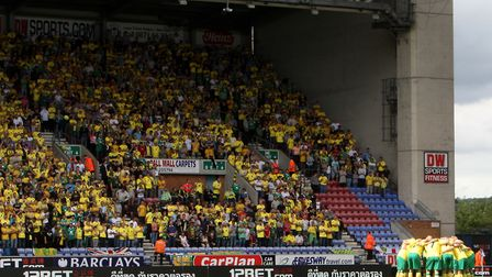 Almost 4,500 Canaries fans went to Wigan in August 2011, as City returned to the Premier League Pict