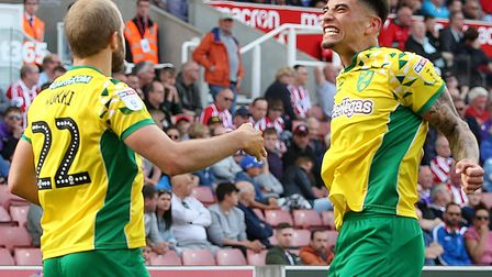 Teemu Pukki celebrates with Ben Godfrey after scoring City's second goal Pictures: Paul Chesterton/