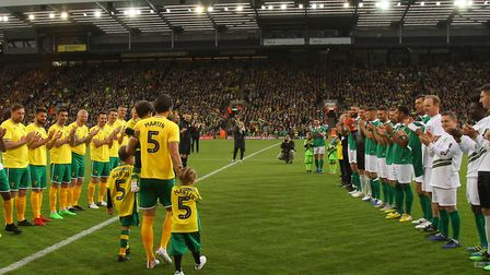 Russell Martin takes a guard of honour as he walks out for kick-off, ahead of his Norwich City celeb