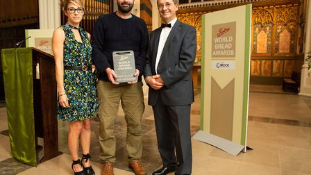 Norfolk baker Ed Clark, centre, picking up his award last year. Picture: Henry Kenyon
