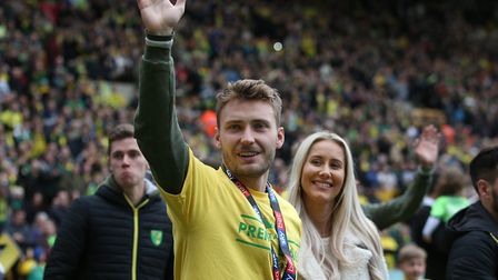 Tom Trybull and his wife, Anna, savour Norwich City's promotion to the Premier League Picture: Paul