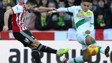 Neal Maupay in action for Brentford, left, against Norwich City Picture: Paul Chesterton/Focus Ima
