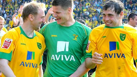 Celebrating Norwich City's League One title win in 2010 are, from left, Stephen Hughes, Michael Nels