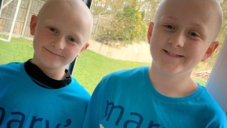 Fin (right) and Cam (left) Tilly from Thetford shaved their heads to raise money for the charity Mar