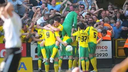Players and fans celebrate Simeon Jackson's famous late winner against Derby Picture: Archant