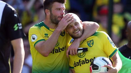 Teemu Pukki of Norwich gets a hug from Grant Hanley of Norwich at the end of the Premier League matc