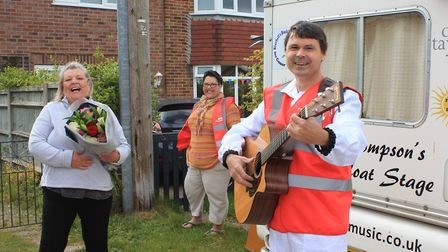 Mutual Aid Sheringham (MASH) co-founder Caz New looks on as 'milk float musician' Paul Thompson help