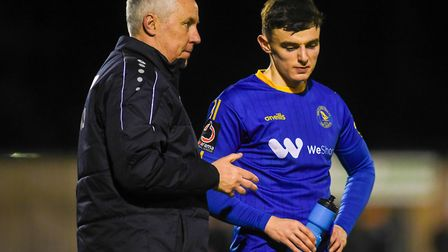 Norwich City loanee Simon Power talking tactics with King's Lynn Town manager - and Canaries legend