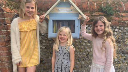 Sisters Sienna, Emilie and Florence outside the Bookworms Beach Hut in Overstrand Road, Cromer. Pict