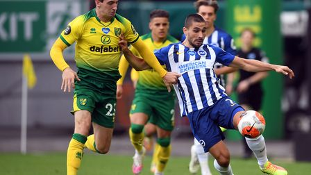 Norwich City's Kenny McLean and Brighton & Hove Albion's Neal Maupay during the Premier League match